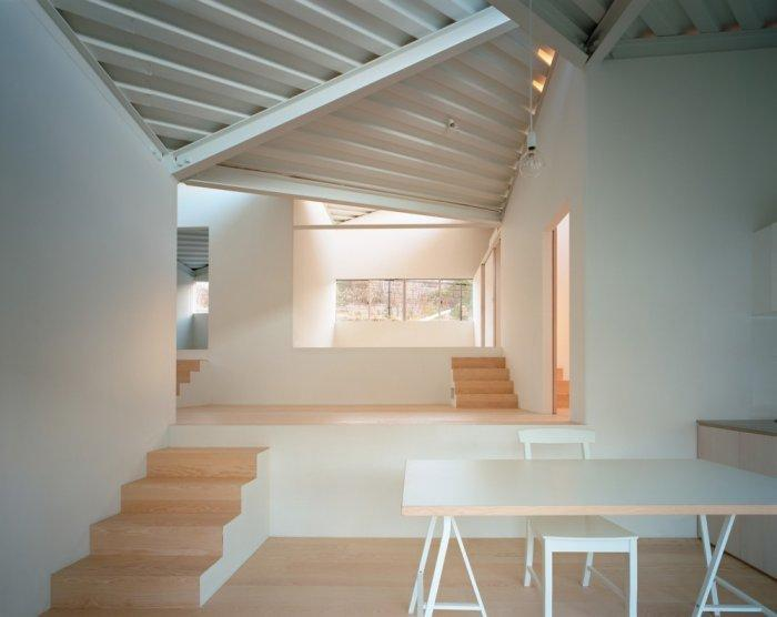 Small minimalist house and its living room in white color