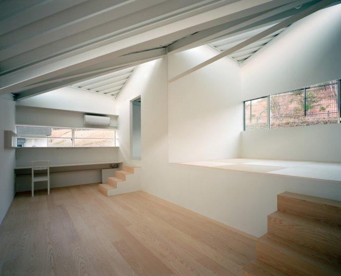 Small minimalist house in white with wooden flooring