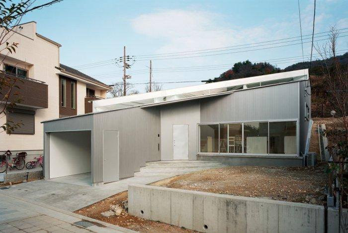 Small minimalist house - the front facade and garage