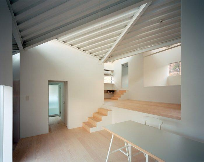 Small minimalist house with two levels of functional areas