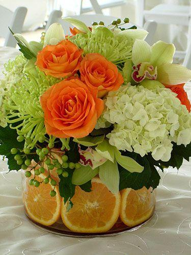 Srping flowers - inade a glass vessel with oranges