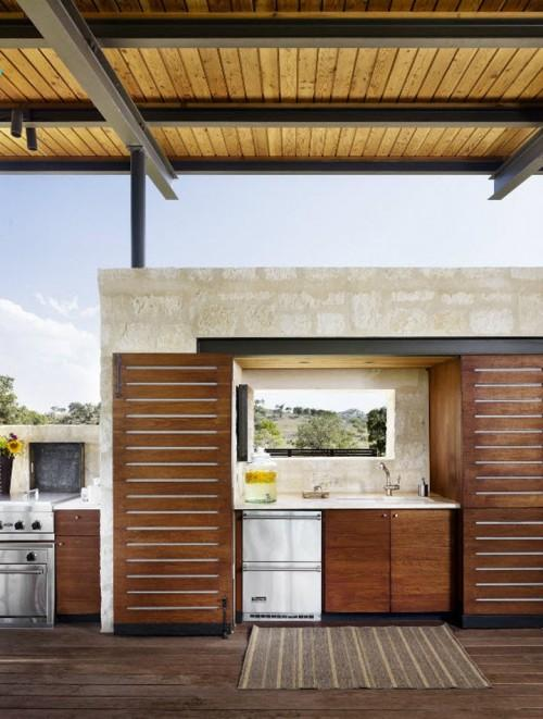 Summer villa - outdoor kitchen with a special area for barbecue