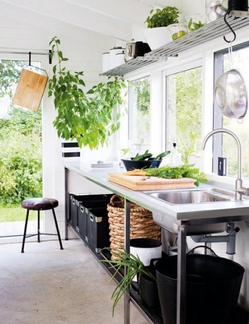 Summer villa - simple and elegant summer kitchen with natural flower decorations