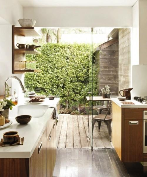 Summer villa - small kitchen with glass sliding door leading outdoors