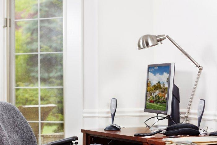 Sunny home office - with elegant wooden desk and small monitor