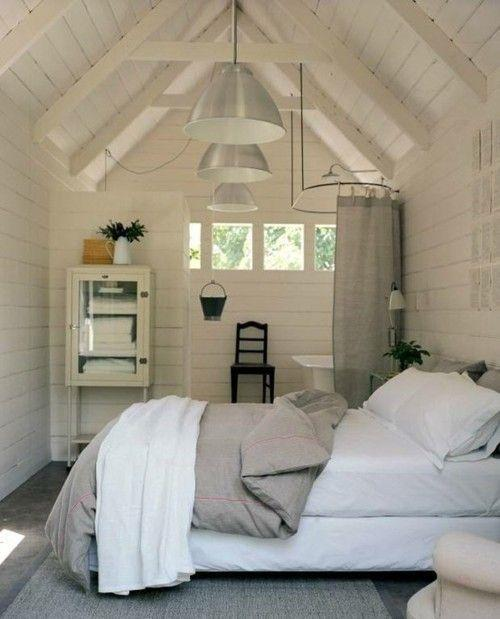 Swedish attic bedroom - with modern stylish pendants
