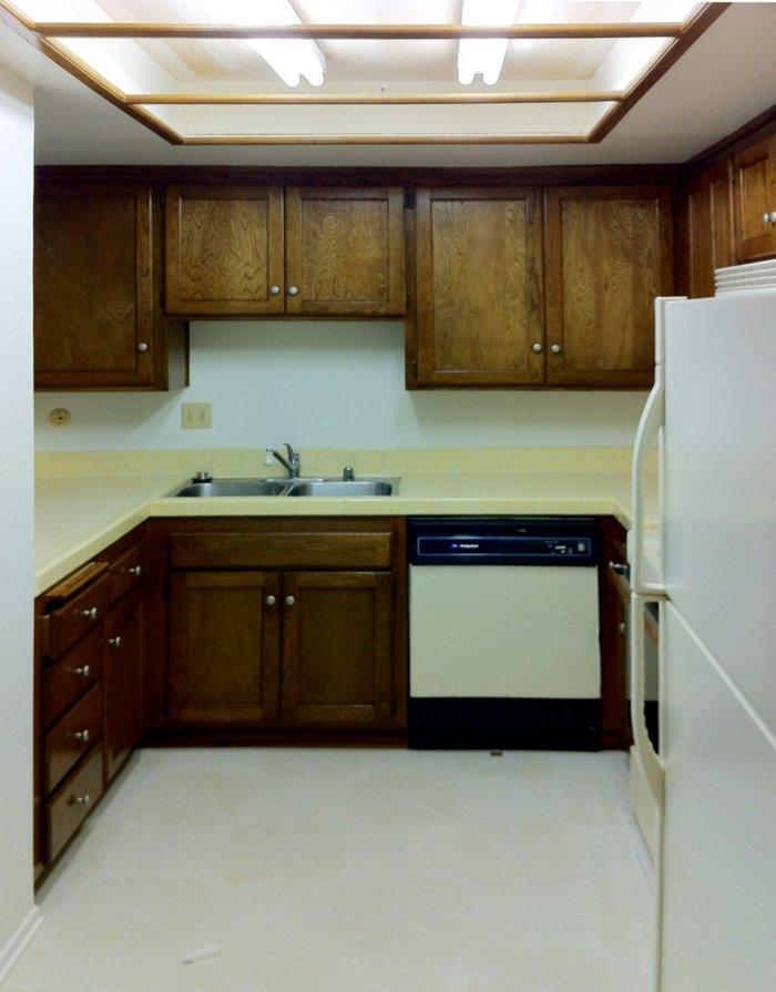 The previous state of the kitchen - with old wood cabinets