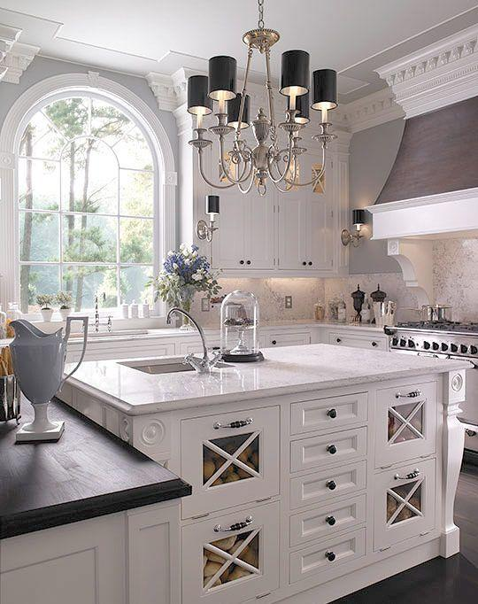 Traditional white countertops - in a fancy house kitchen