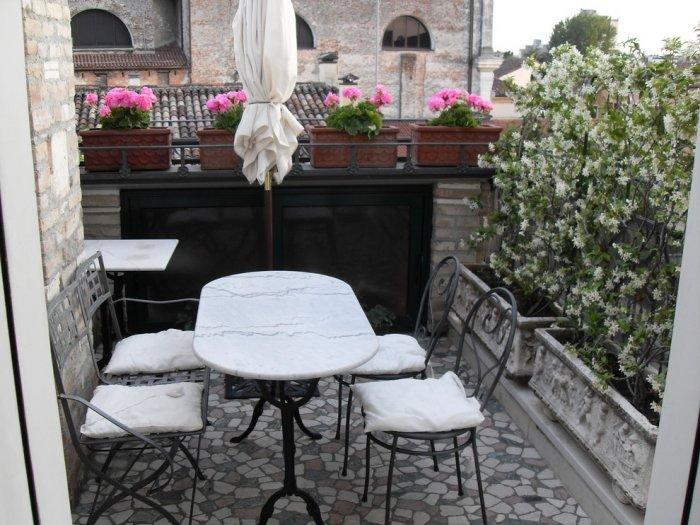 Very small balcony in italian style with attractive flowers
