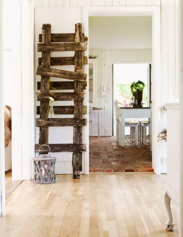 Vintaga ladder - leaned on a white wall
