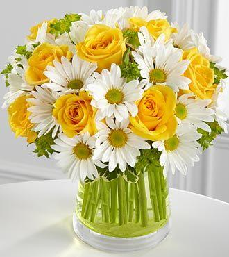 White and yellow flowers - inside a glass vessel full of water