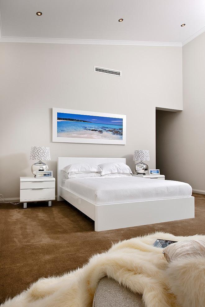 White bedroom design in a home near the ocean shore