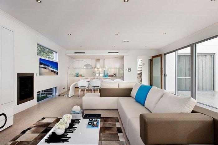 White living room with brown accents