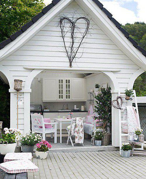 White shed with beautiful porch