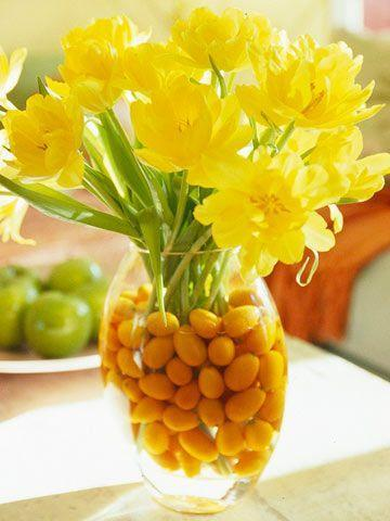 Yellow spring flowers - in a glass jar full of berries
