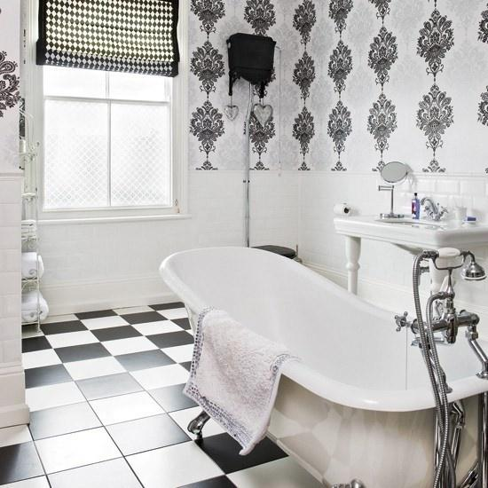 Apartment white bathroom - with bathtub and creative wallpaper patterns