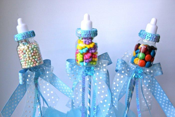 Baby shower feeding-bottles - with blue ribbons and sweets