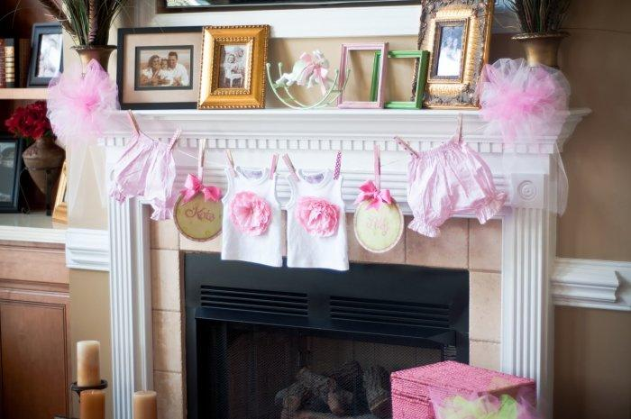 Baby shower surprises - a garland at the fireplace mantel