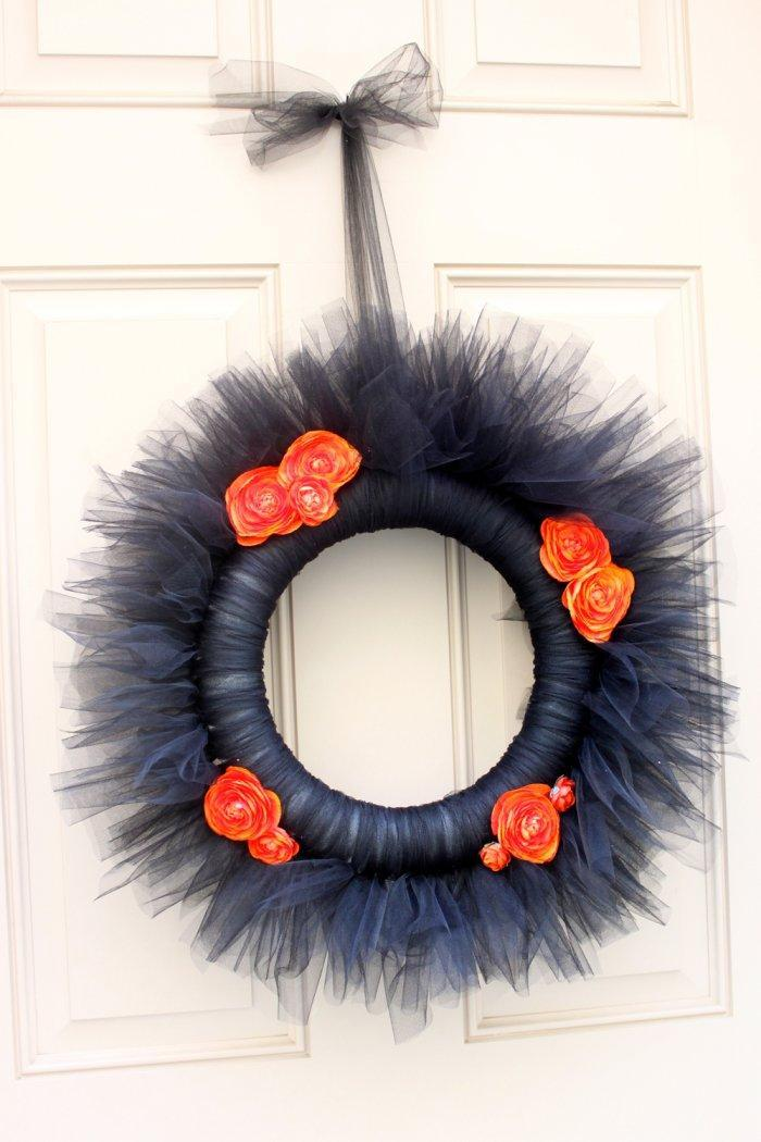 Black Halloween wreath - with small orange rose blossoms
