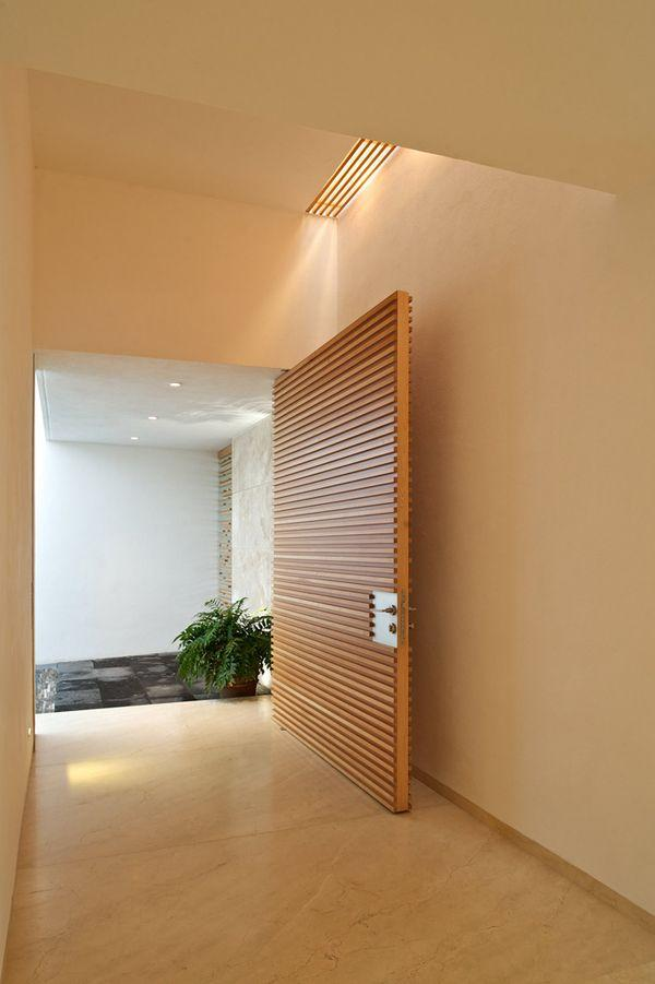 Brown minimalist front door - wide opened