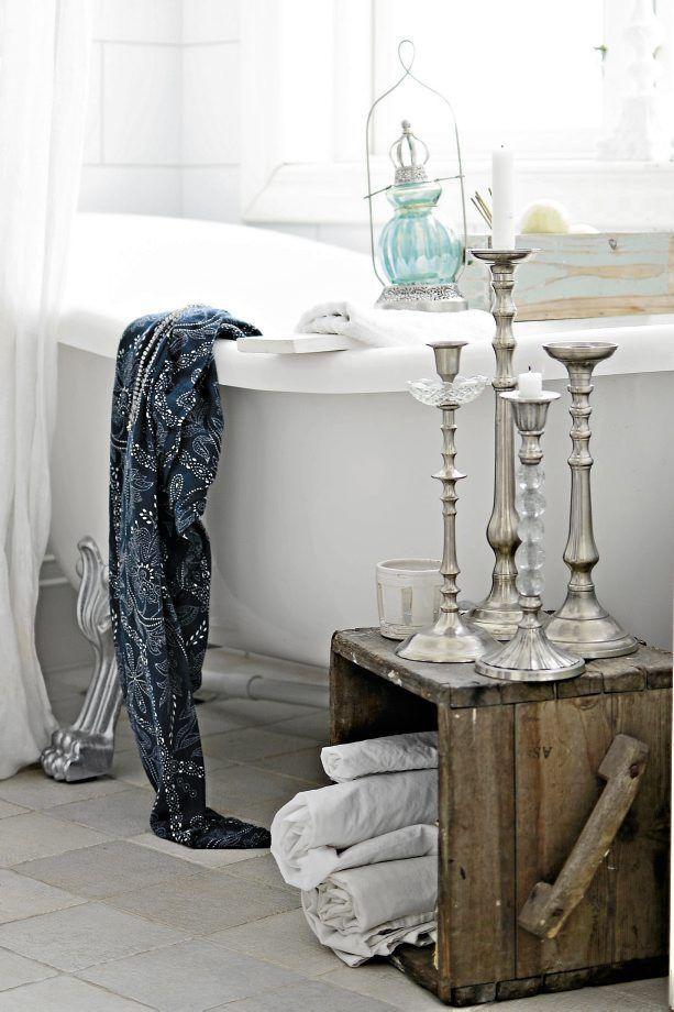 Classic candleholders - inside a white bathroom
