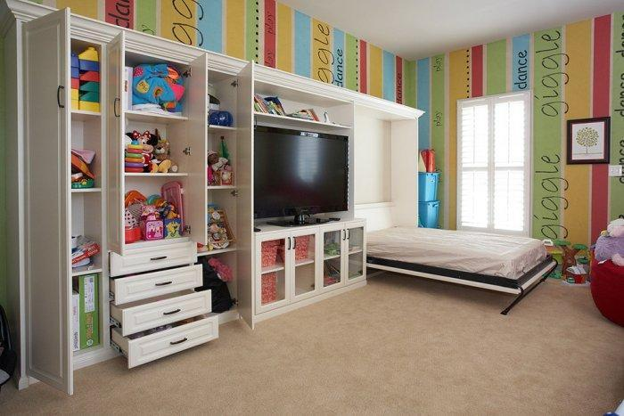 Colorful kid room with wall bed - unfolded and prepared for a sleep
