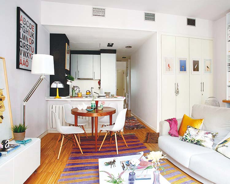 Colorful Small Living Room With Graphic Rug And White Sofa
