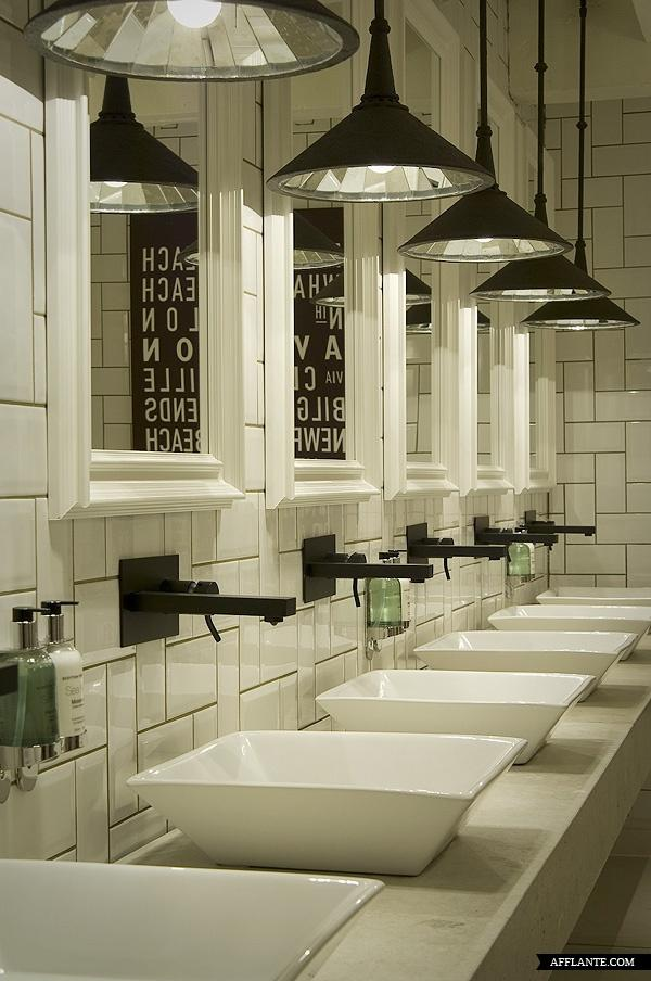Contemporary restaurant restroom - with industrial touches and traditional lines