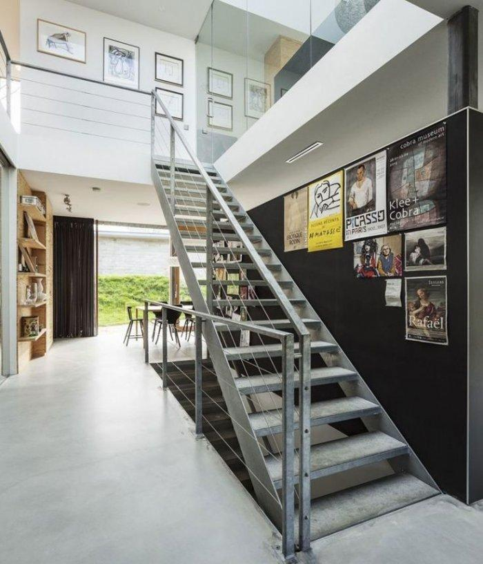 Contemporary staircase - with wall posters