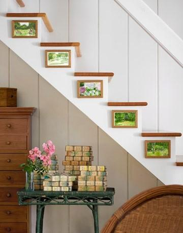 Cozy house white staircase - with small paintings on each step