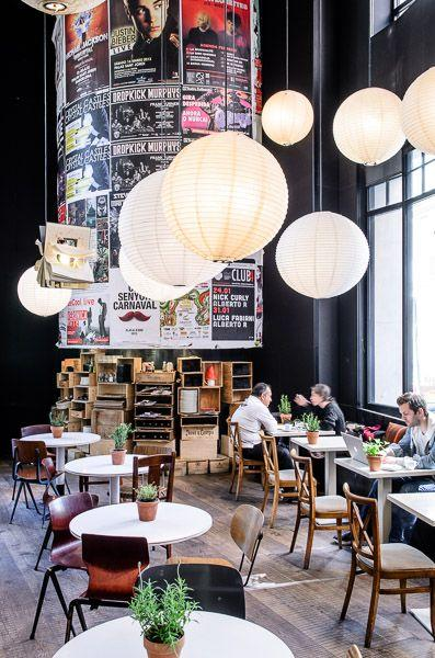 Creative modern coffee shop - with high ceoling and ball pendants