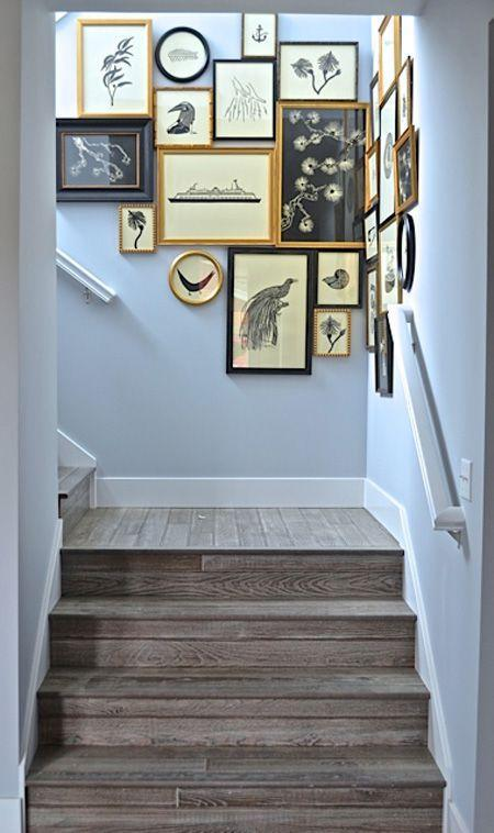 Creative modern staircase design - with various images on the wall