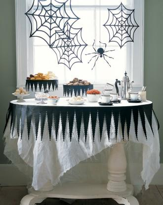 DIY Halloween party table - with black and white cloth and spider nets