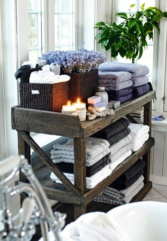 Decorative bathroom candles - placed on the towel storage cart