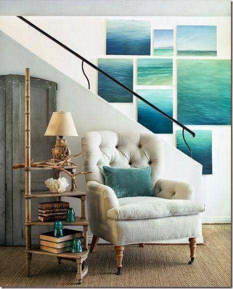 Eclectic staircase with paintings - of the ocean