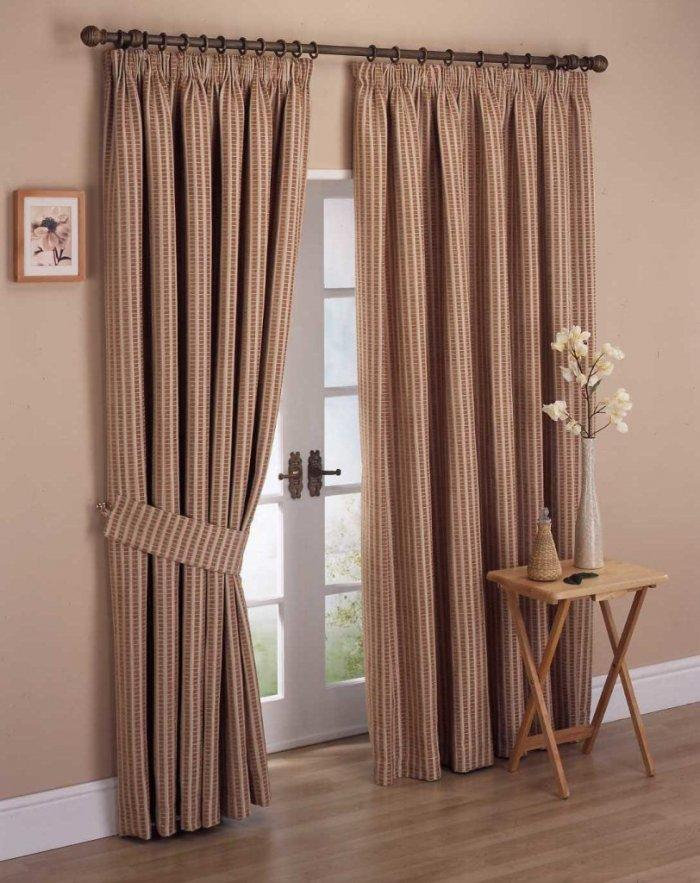 elegant curtains inside pale painted bedroom