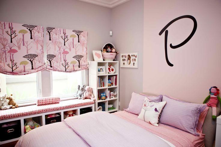 Feminine pink bedroom - with the letter P written above the bed
