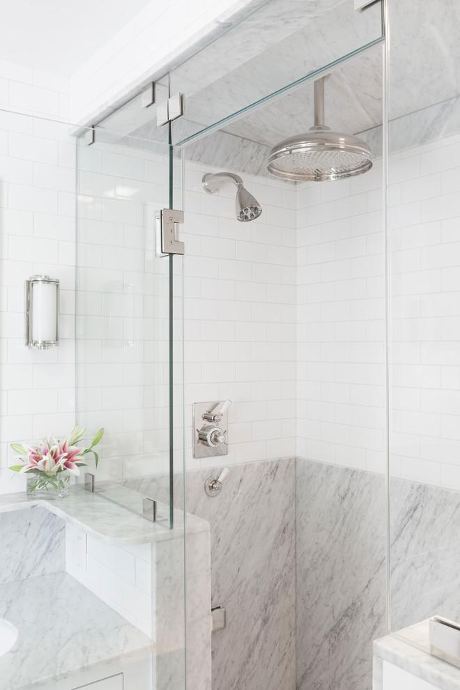 Feng shui shower area - with marble cabin and white tiles