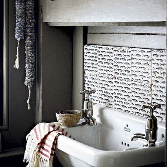 Fish patterned tiles - above the sink