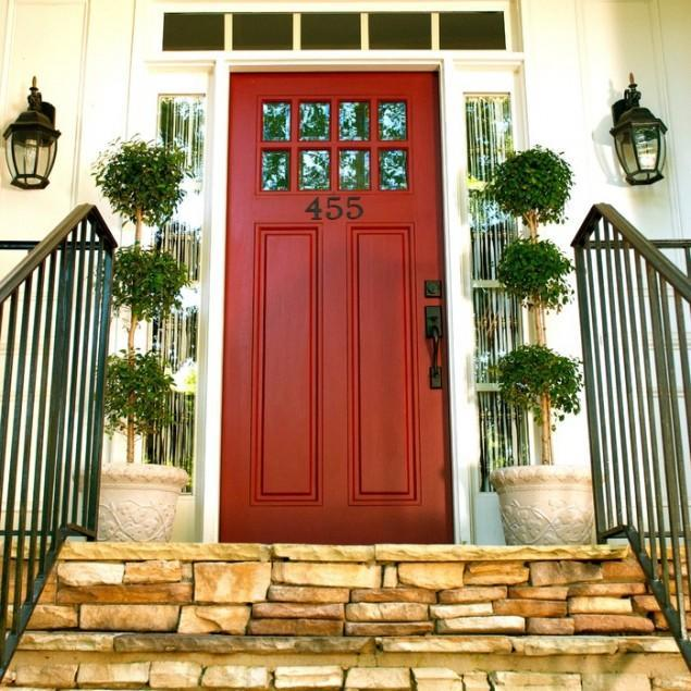 Black double front door entering the garden of a - What does a red front door mean ...