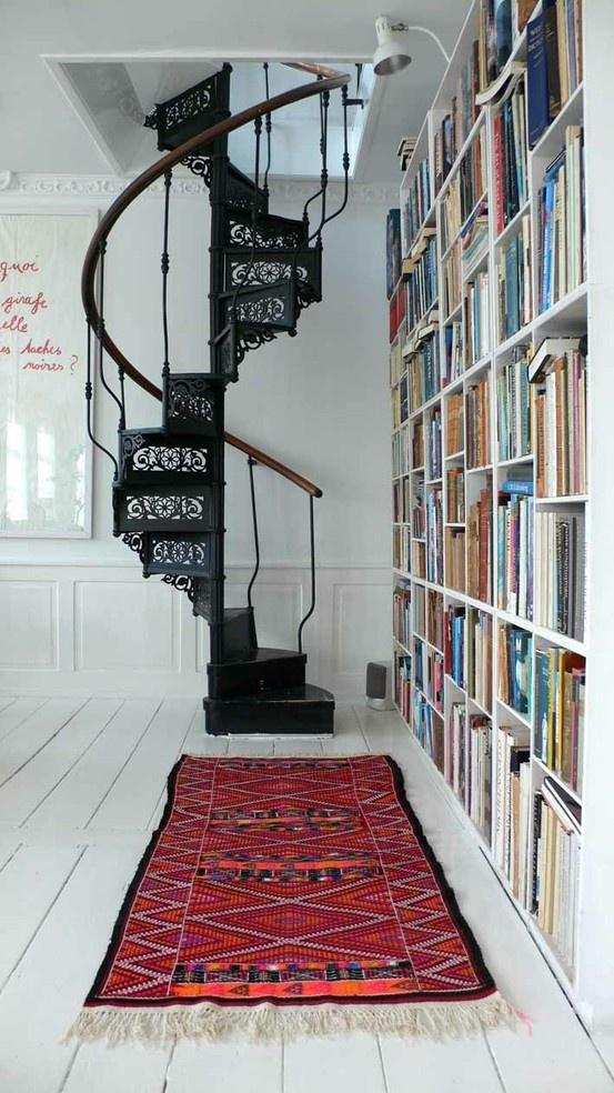 Gothic black staircase - and bookshelves on the level bellow
