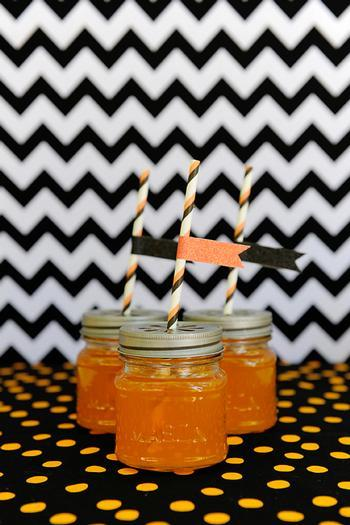 Halloween kids jar of honey - with decorative flags on the top