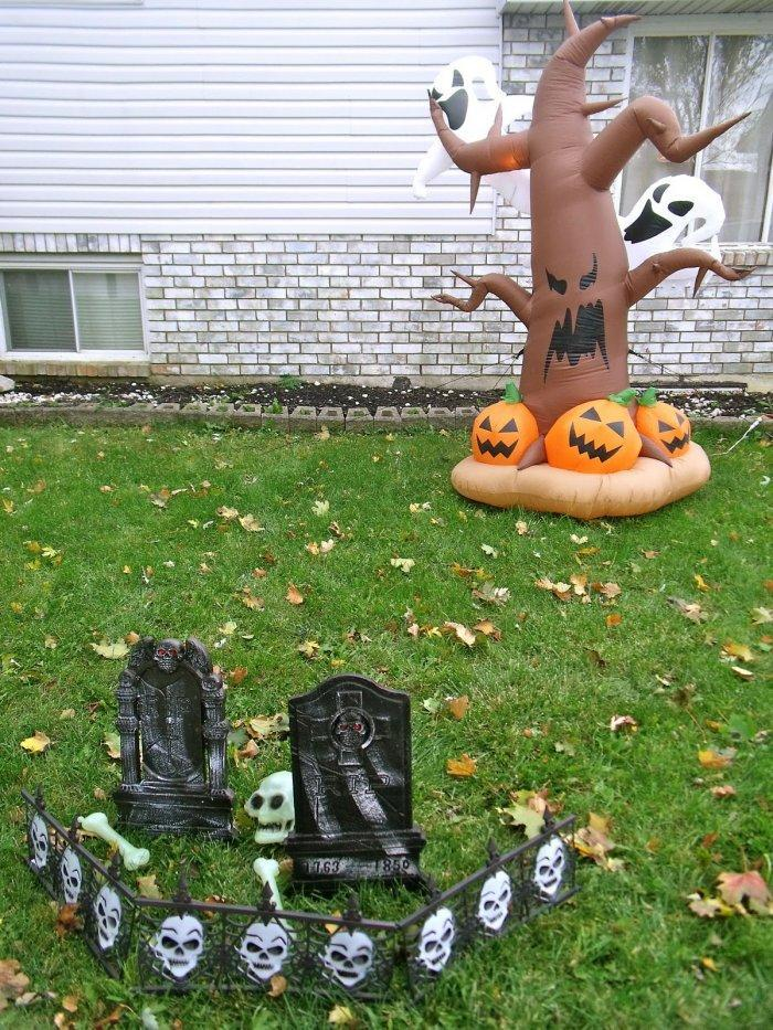 Halloween yard with inflatable tree - and small grave stones and skulls