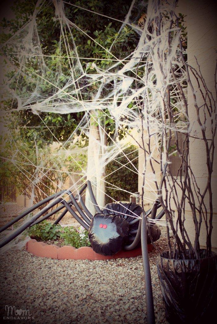 Halloween yard with spider - and a lot of spider nets