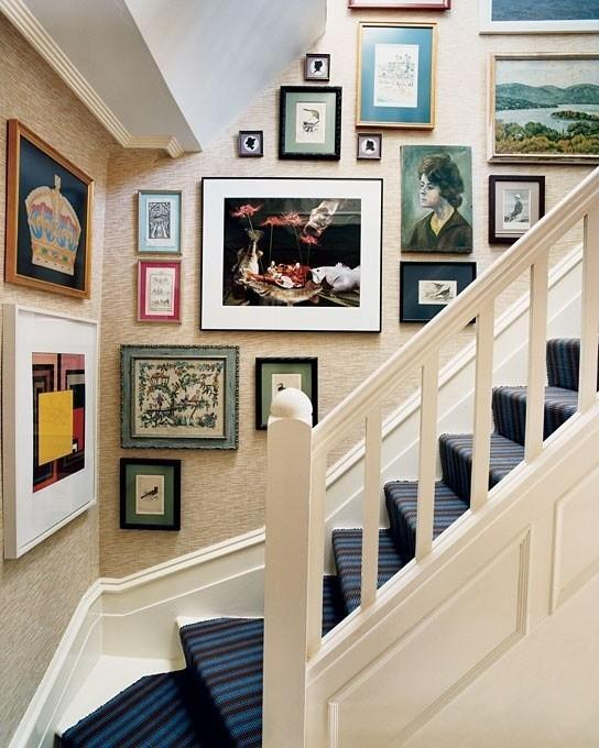 House staircase with images - portraits, landscapes and abstract art