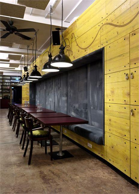 Industrial cafe interior - and yellow wall for a colorful accent