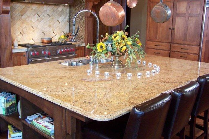 Light granite countertop – placed on a square kitchen island ...