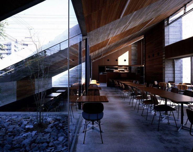 Minimalist cafe - with glass facade and tables