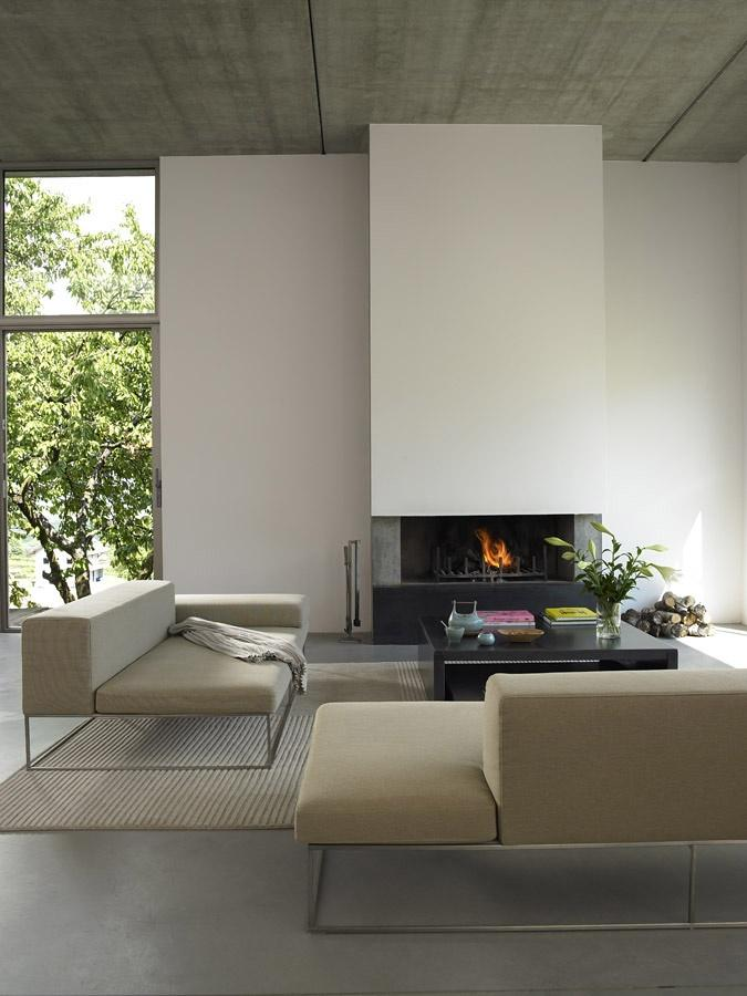 Minimalist living room - with stylish white fireplace in the background