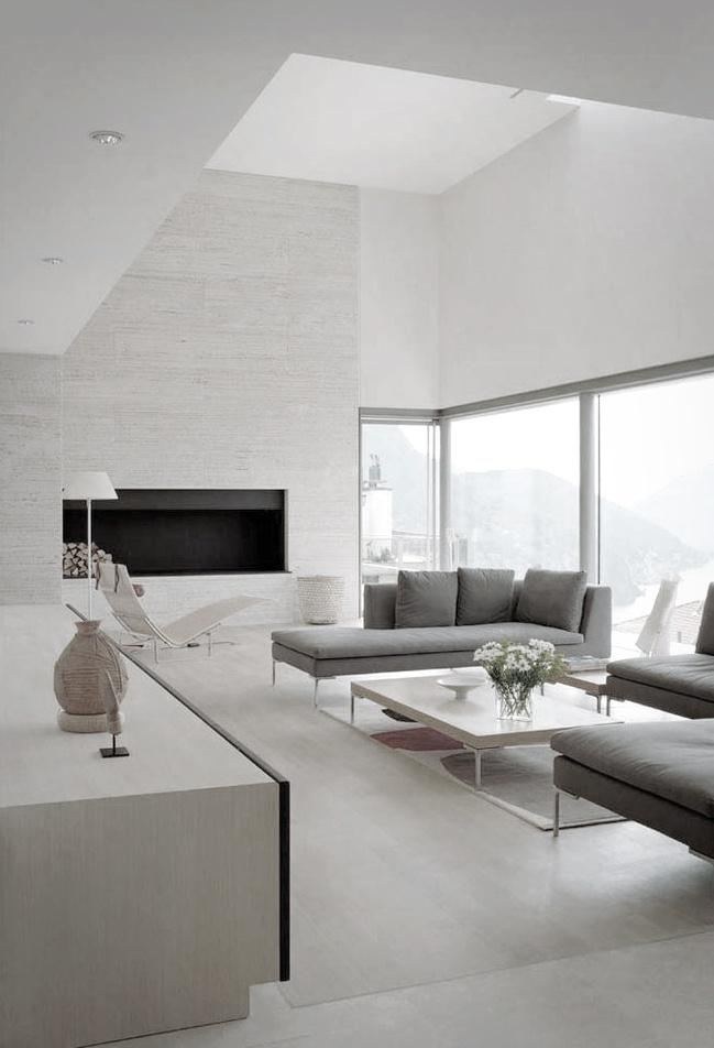 Minimalist white living room - with grey sofas and low coffee table
